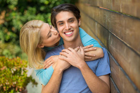 perfect teeth: Happy couple hug and kiss with perfect teeth smile as lovers Stock Photo