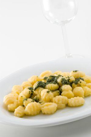 Italian gnocchi with pesto sauce. photo