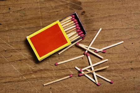 matchbox: Matchbox on old table. Stock Photo