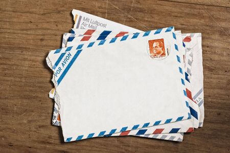 Vintage airmail envelopes on an old wooden table. Stock Photo - 3429039