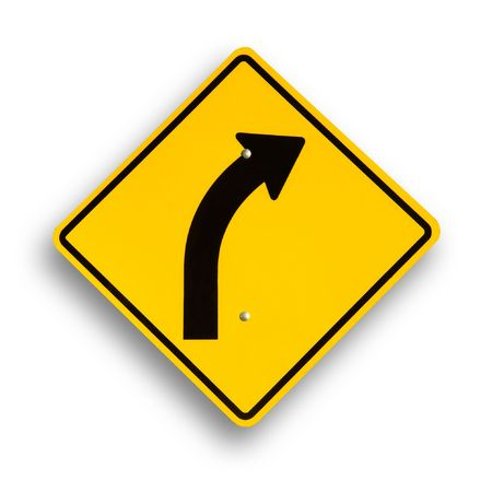 Curve sign isolated on white, clipping path excludes shadow. photo