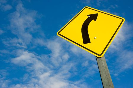 road sign against a blue sky with clipping path. photo