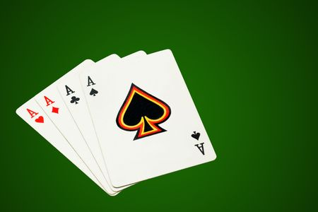 Four aces, poker cards on green background, isolated, clipping path excludes the shadow.