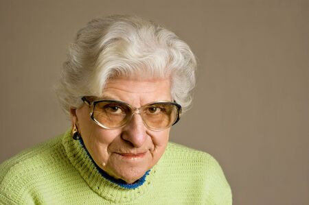 Senior lady portrait, smiling, glasses, with copy space. Stock Photo
