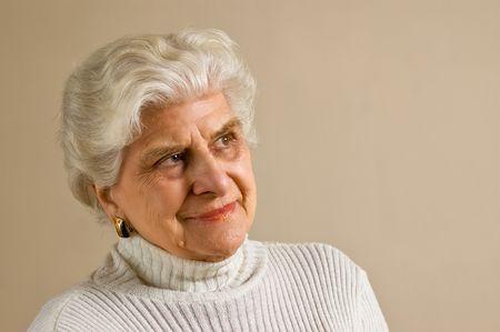 Senior lady portrait, smiling, with copy space.