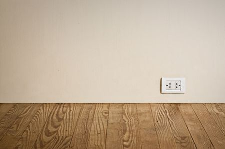 grounded plug: electric outlet in a wall in an old  interior Stock Photo