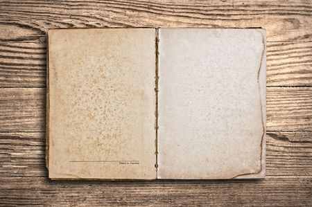 Vintage book with blank pages over an old wooden table. photo