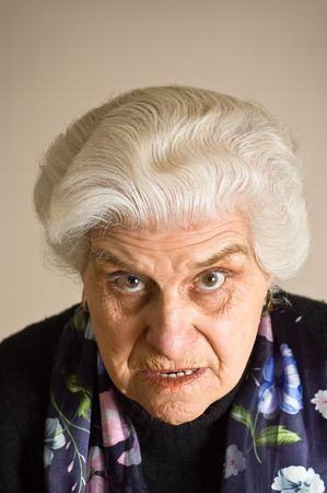 Portrait of an angry mature woman, looking to cammera. photo