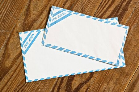 old airmail envelopes over an old wooden table. Stock Photo - 3709561