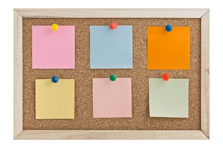 Post it notes on a cork board wiht thumbtacks. photo