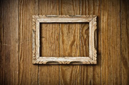 Blank vintage picture frame on a wooden wall. Stock Photo - 3792013
