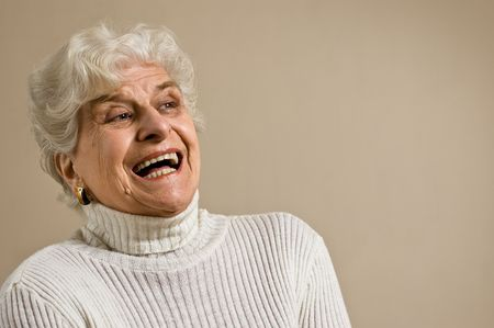 amiable: Senior lady portrait, laughing, with copy space.