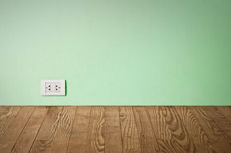 electric outlet in a wall in an old house interior photo