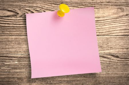 Pink paper note with thumbtack on wooden surface, path. photo