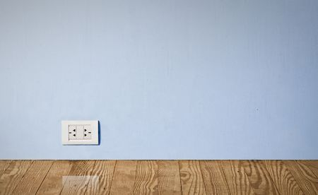 grounded plug: electric outlet in a wall in an old house interior