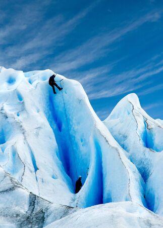patagonia: Two men climbing a glacier in patagonia.