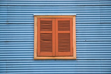 Old window in a traditional house in la boca neighborhood, Buenos Aires. photo