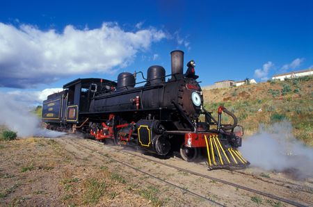 steam engine: Touristic steam engine train leaving the station in Patagonia, Argentina.