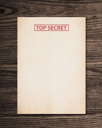 Top secret document on old wooden table. Stock Photo