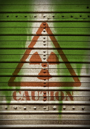 Radiation warning sign over metal surface with wiht screw nuts. photo