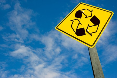 Recycle symbol on traffic sign, on a blue sky. photo