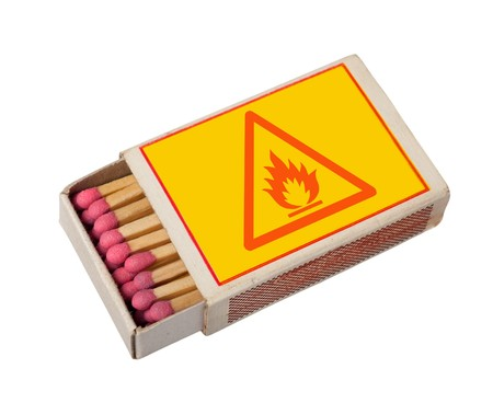 Yellow  matchbox with hazard sign isolated on white photo