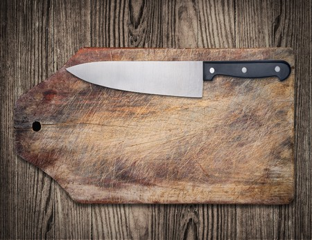 cutting boards: Kitchen knife on wooden cutting table Stock Photo