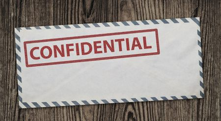 Confidential  envelope on wooden background Stock Photo - 8212389
