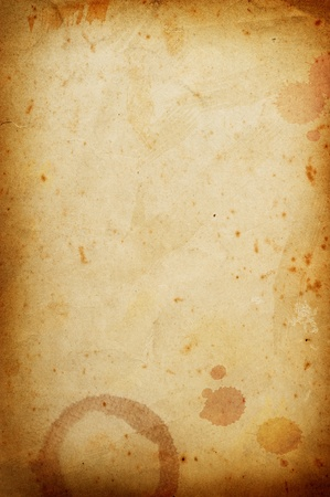 Vintage grungy papier met koffie ringen vlek.