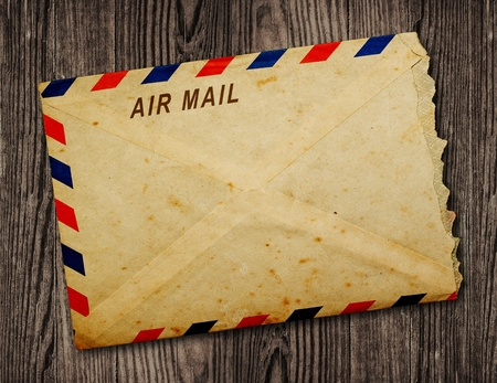 Vintage  envelope on wooden table photo