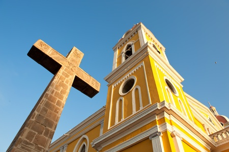 Cathedral and stone cross, Granada, Nicaragua, Central America.
