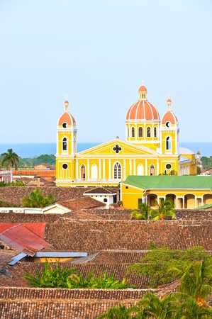 Granada cathedral and lake Nicaragua on the background, Nicaragua.