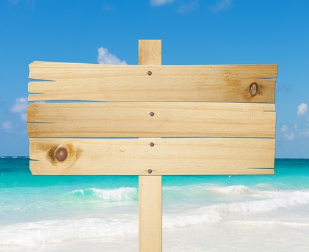 holiday summer: Wood sign in the beach Stock Photo