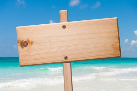 Wood sign in the beach, with clipping path. Archivio Fotografico