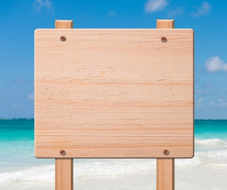 Wood sign with beach on the background.