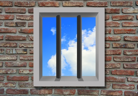 Prison window with bars, brick wall, sky behind. photo