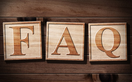 faq's: FAQs 3D Text with wooden background.