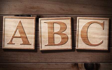 ABC 3D Text with wooden background. photo