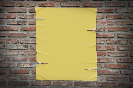 old paper on brick wall, clipping path. photo