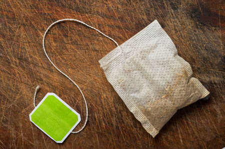 teabag: Tea bag on wooden table. Stock Photo
