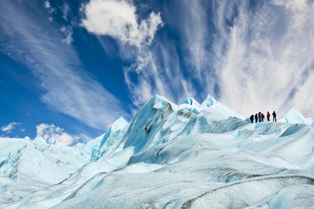 Climbers walk up on Moreno glacier in Patagonia, Argentina. photo