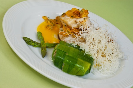 Chicken geourmet dish with asparagous. photo