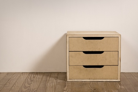 traditional goods: Chest drawer in the interior of an old room. Stock Photo