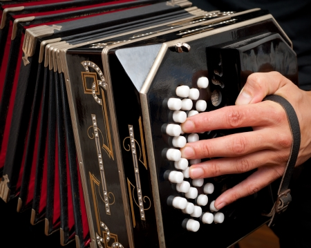 aerophone: Playing the bandoneon, traditional tango instrument, Argentina. Stock Photo