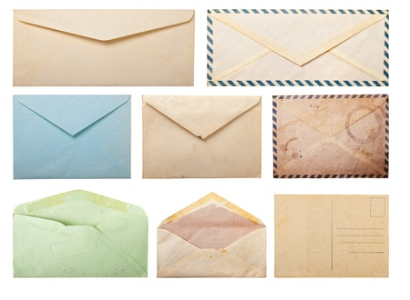 Collection of old envelopes and postcard, isolated on white. photo