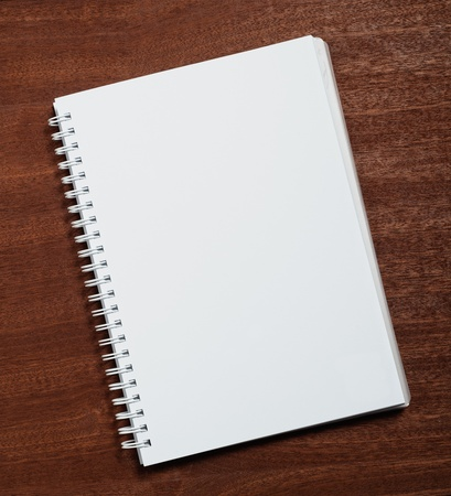 Notebook on wooden background.  photo