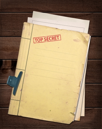 top secret file on wooden table