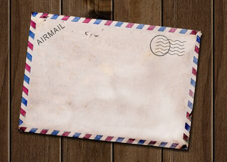 Old blank post card wooden background  photo