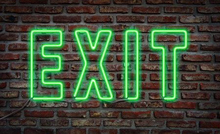 Glowing neon  exit  sing on a brick wall  photo