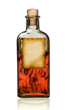 Old fashioned drug bottle with label, isolated, clipping path.  photo